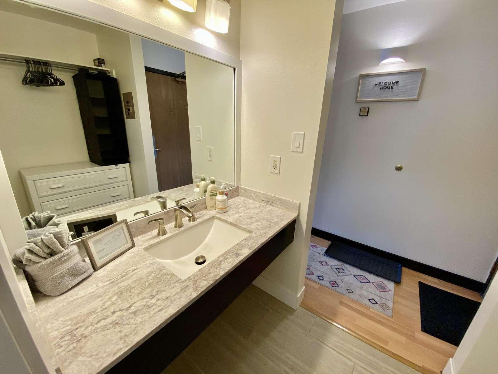 Separate sink area just outside bathroom door