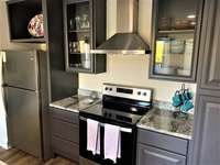 Designer grey cabinets with stainless steel exhaust fan thumb