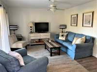 Coastal feel open floor plan and pull out sofa thumb