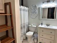 Master bath with a walk-in tiled shower and oversized vanity thumb