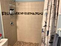 Oversized tiled walk in shower thumb