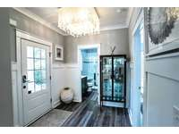 Coastal Feel in this Entry with Full Bath and Main Level Bedroom thumb