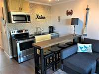 Renovated Kitchen with full sized stainless appliances thumb