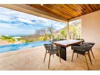 Outdoor dining area, poolside, ocean views thumb