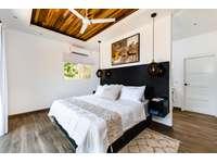Master bedroom, King bed, ensuite bathroom, ocean views thumb