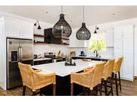 Spacious kitchen area, oversized island with seating thumb