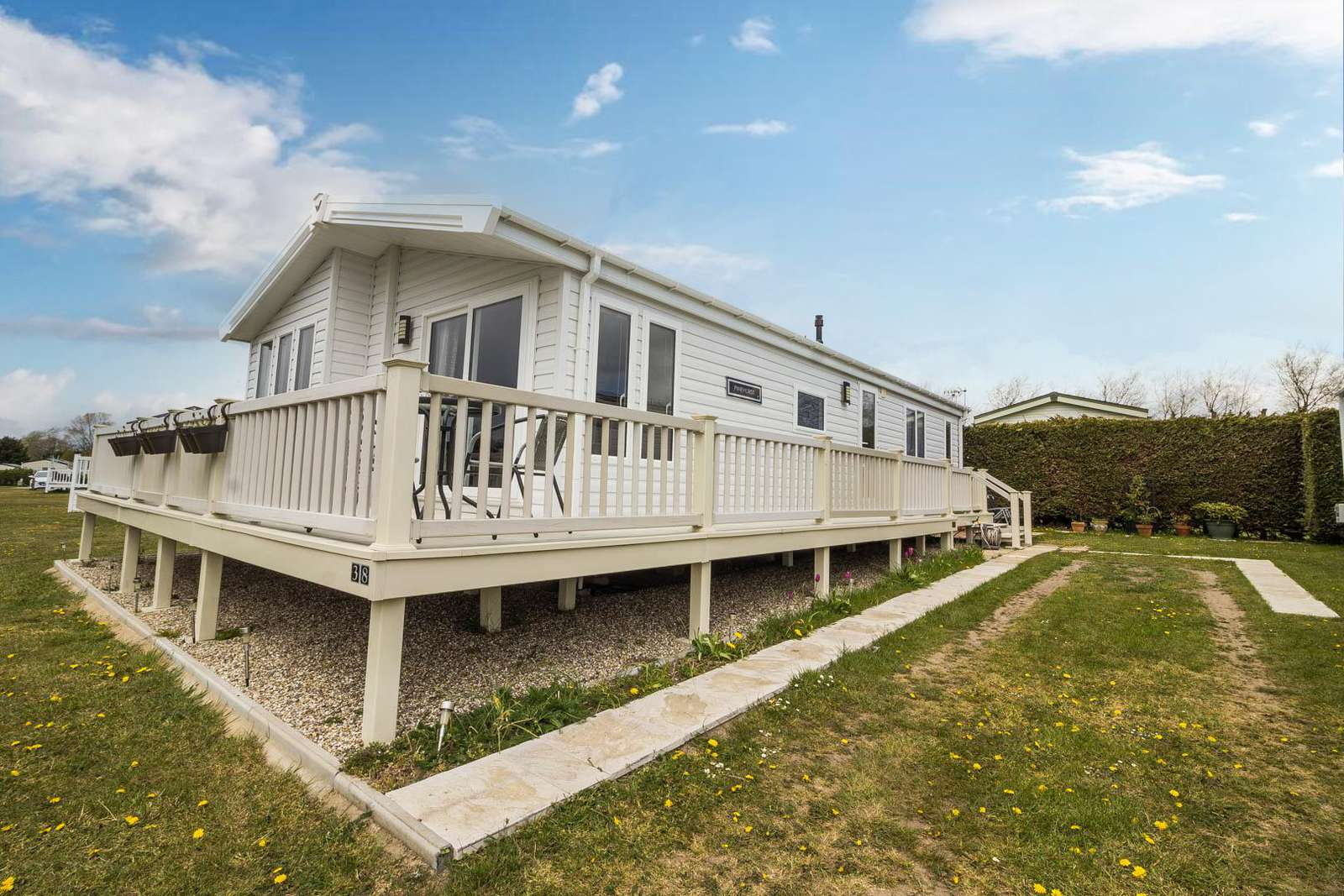 10038B – Bure Village, 2 bed, 6 berth lodge with decking. Platinum Deluxe rated. - property