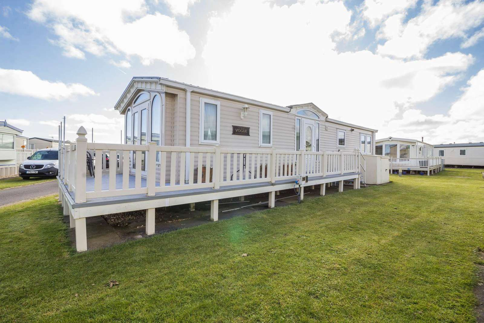 42076S – Sunkist, 2 bed, 4 berth caravan with decking, D/G & C/H. Diamond rated. - property