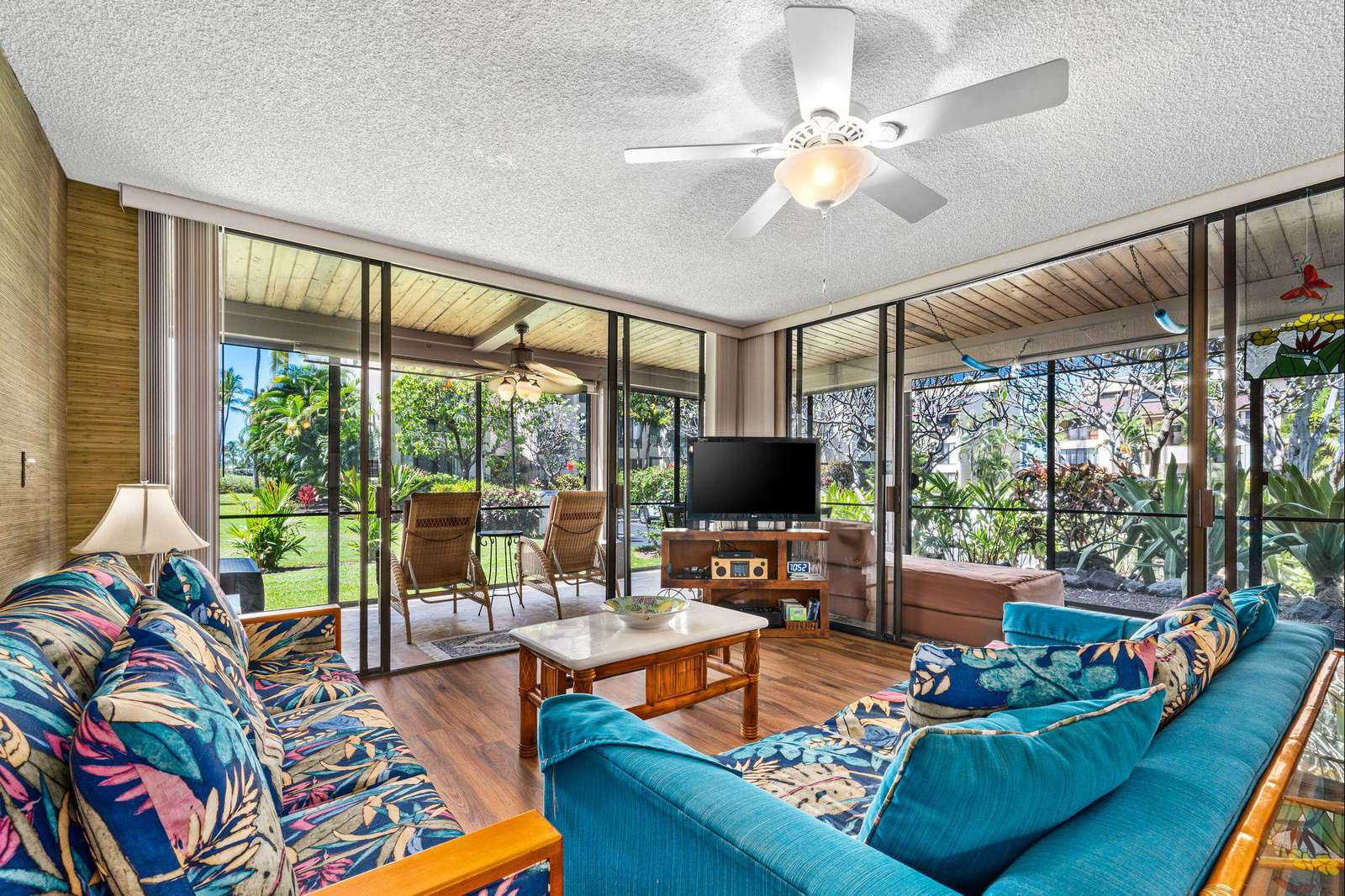 Huge living area with wraparound and screened in lanai.