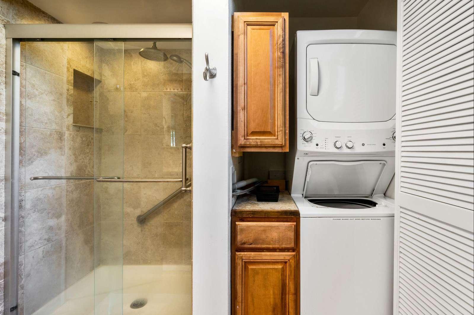 Master bath has a washer/dryer