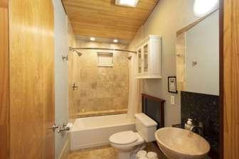Bathroom tub with dual showerheads. thumb