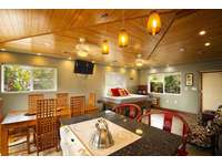 Full kitchen, dining area, full size daybed in den area.. thumb