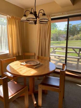 Roomy dining with views of Mount Snow trails thumb