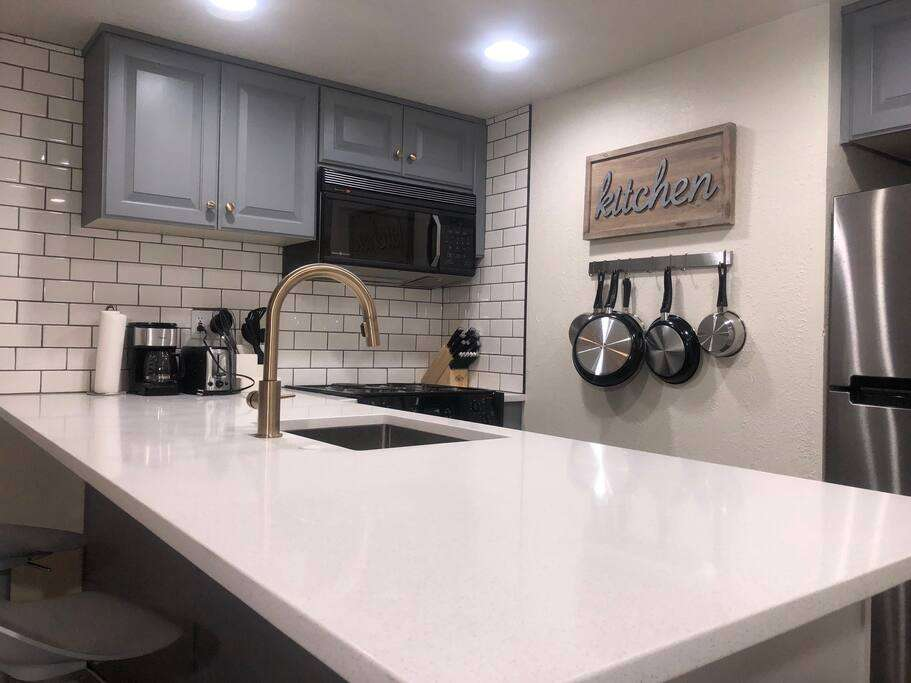 New kitchen:  quartz counter top, refinished cabinets, brass finishes...