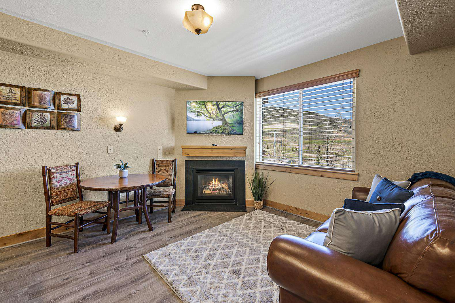 Inviting living room with dining table, fireplace, and smart TV