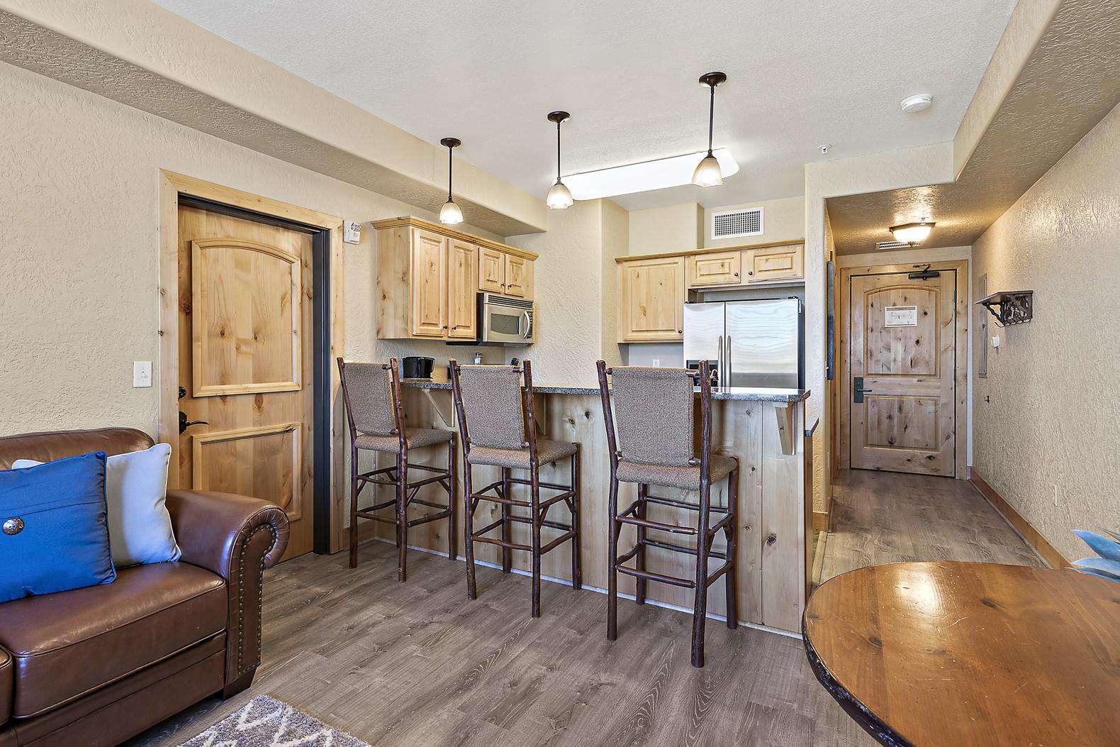 Living room and breakfast bar with closed master bedroom door
