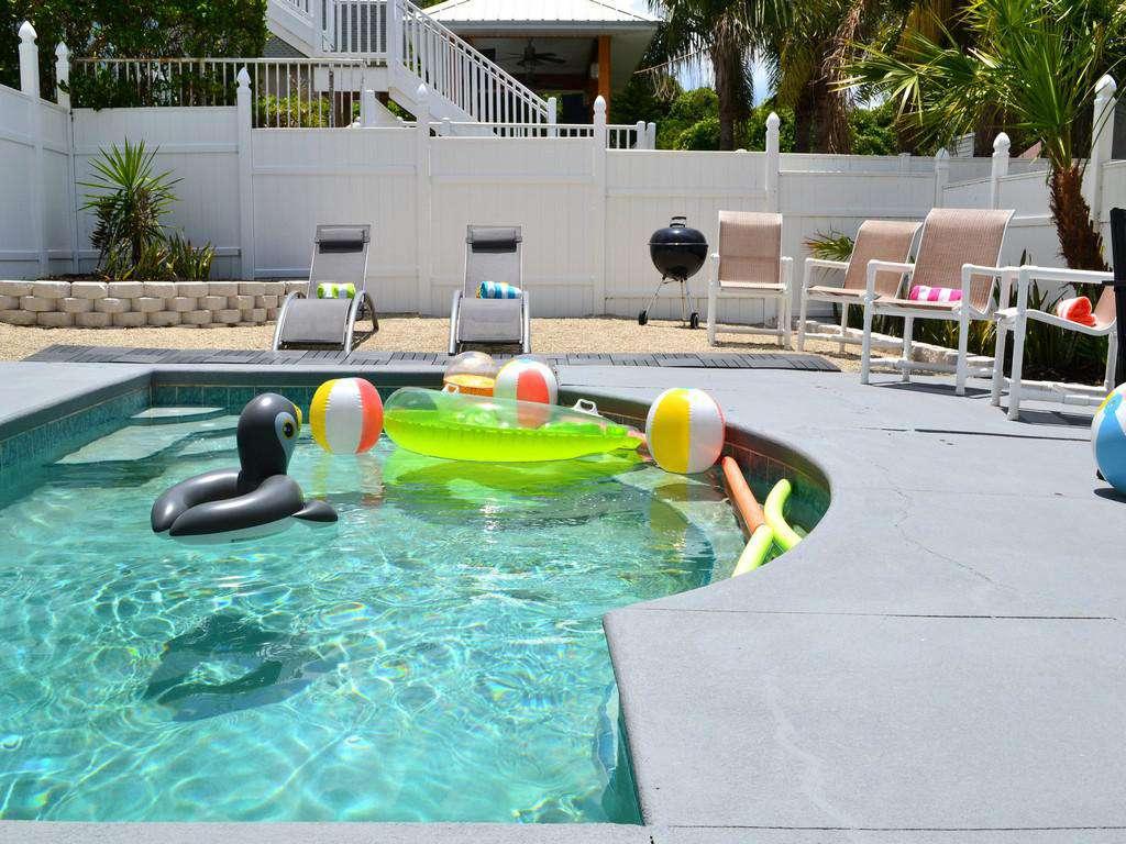 Purple Pelican - Pool with Patio Furniture