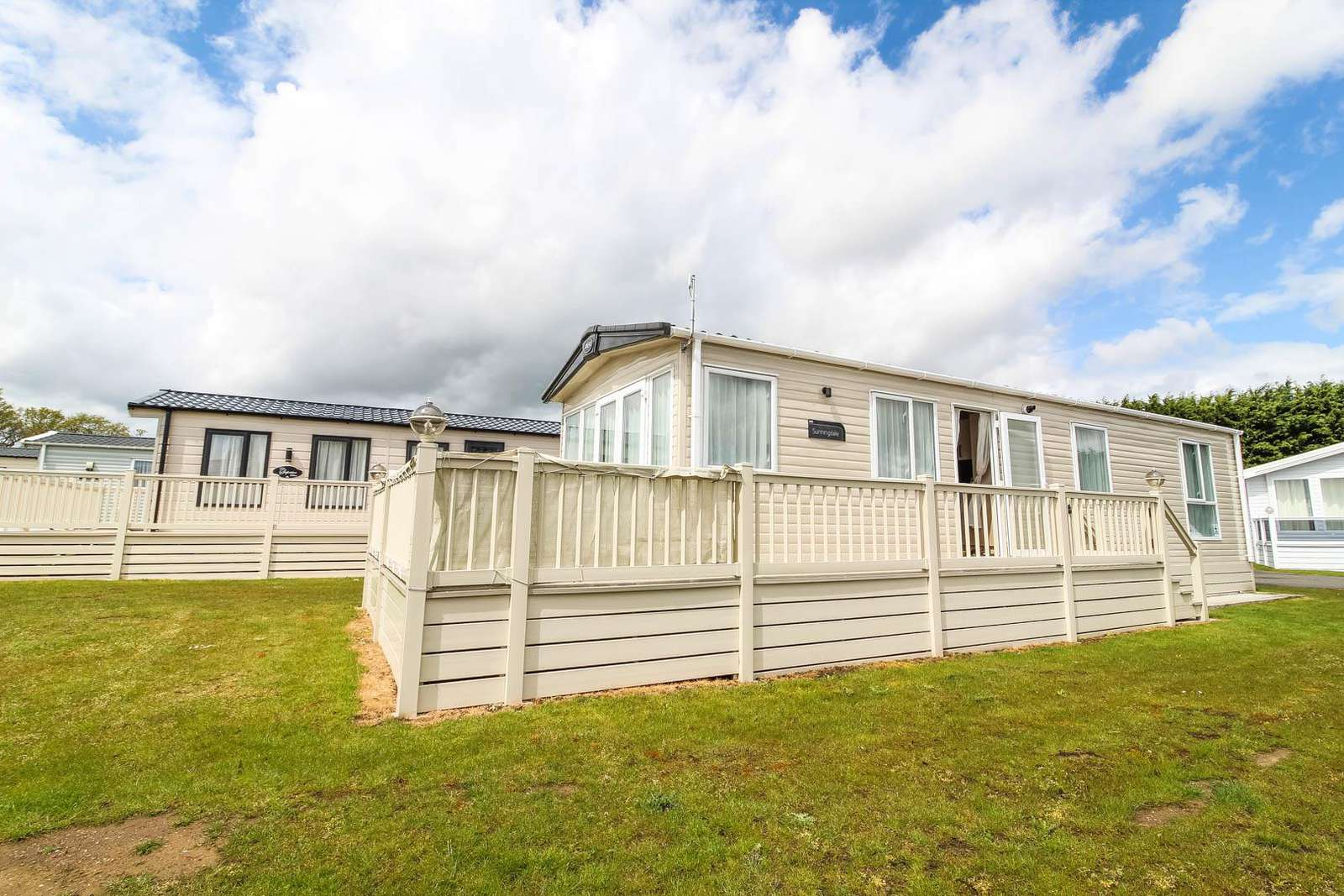 60037FW- Forest Walk area, 2 bed, 6 berth caravan with decking area. Diamond-Plus rated. - property