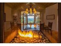 Living Room Fireplace View Toward Lanai thumb