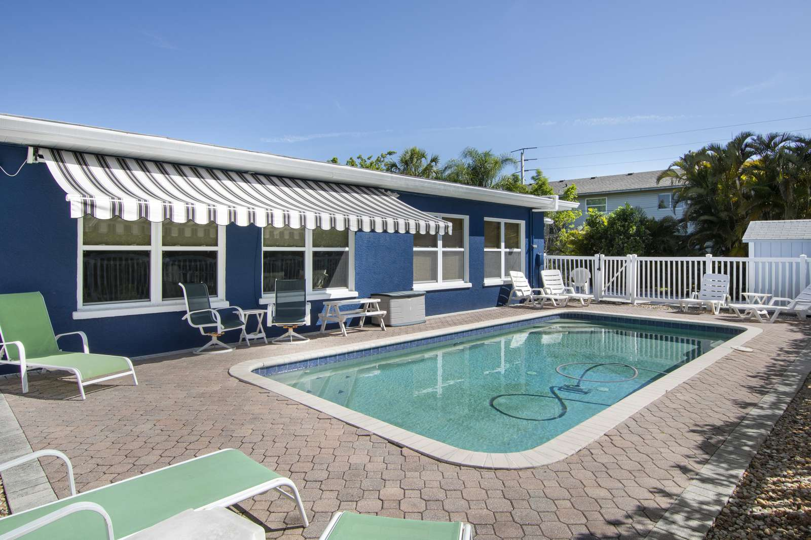 Heated pool and retractable awning