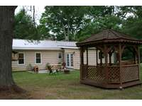 Back of cabin showing picnic area and gazebo thumb