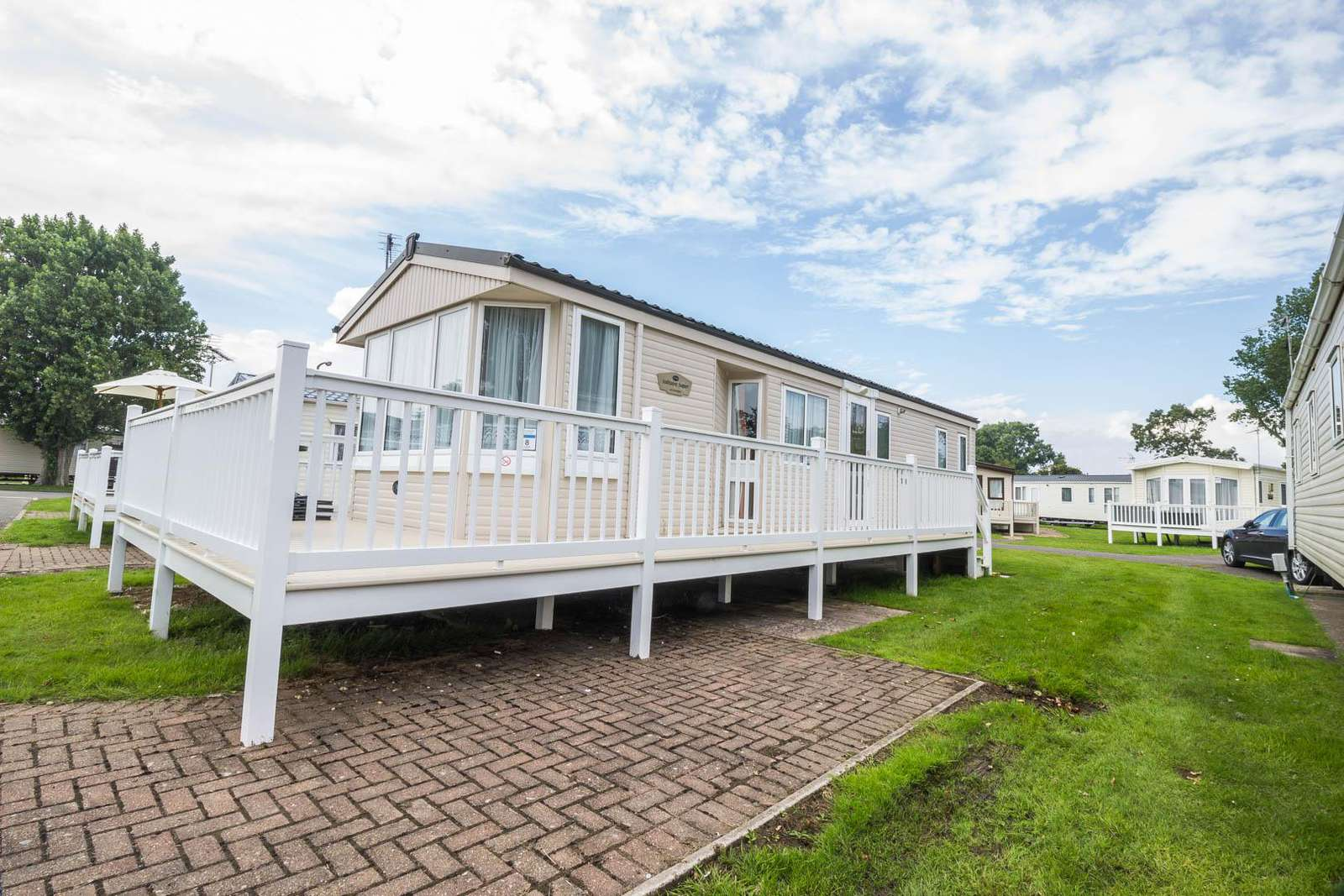17008WC – Wyndham Court area, 2 bed, 6 berth caravan with decking, D/G & C/H. Ruby rated. - property