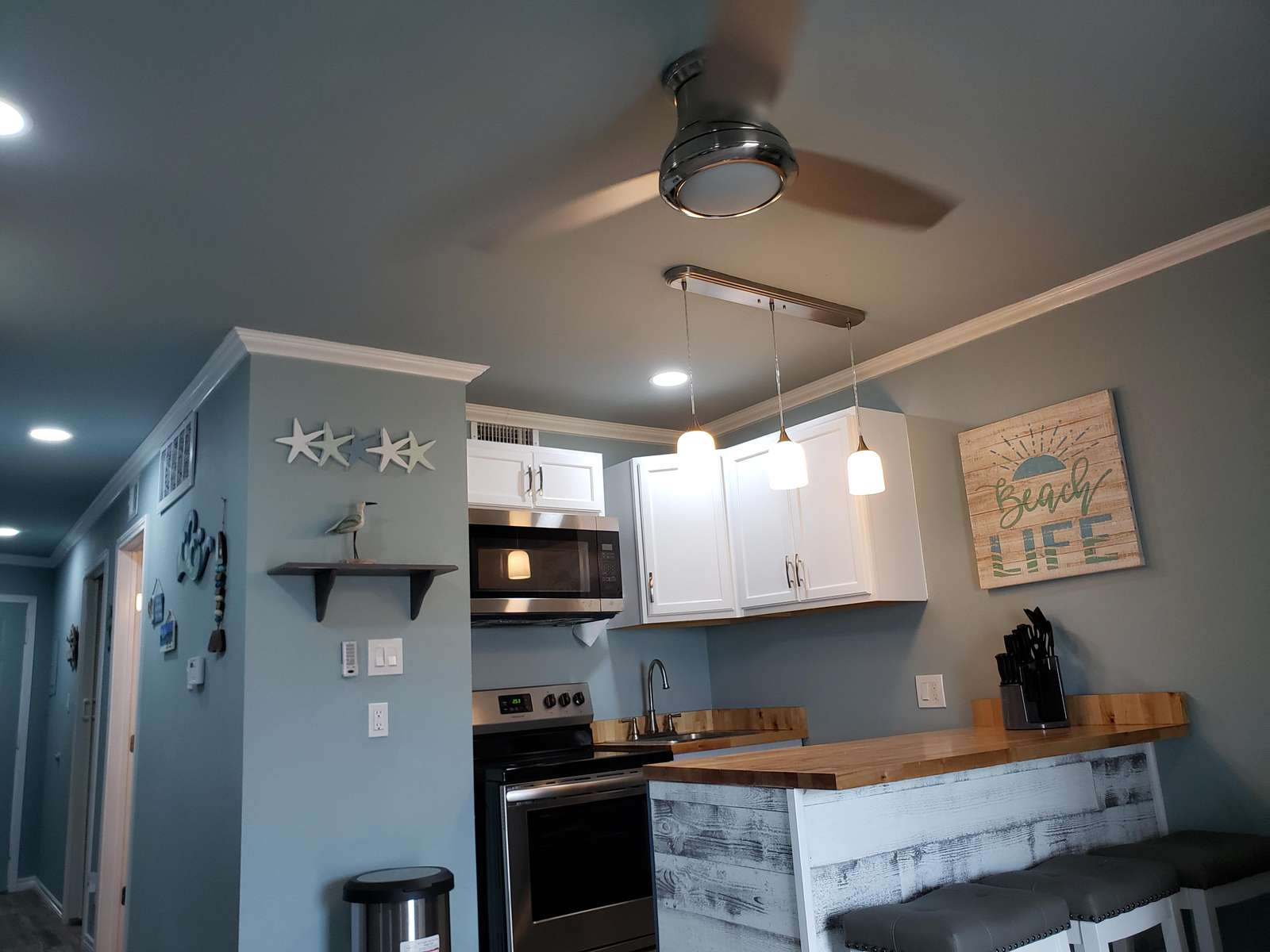 ceiling fans in the living area and bedroom