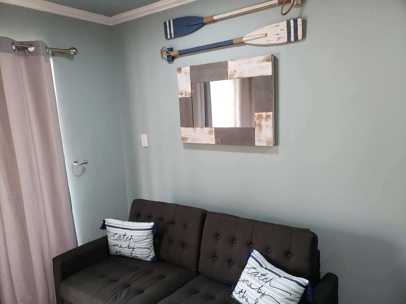 comfortable seating provided and a mounted 50 inch smart tv