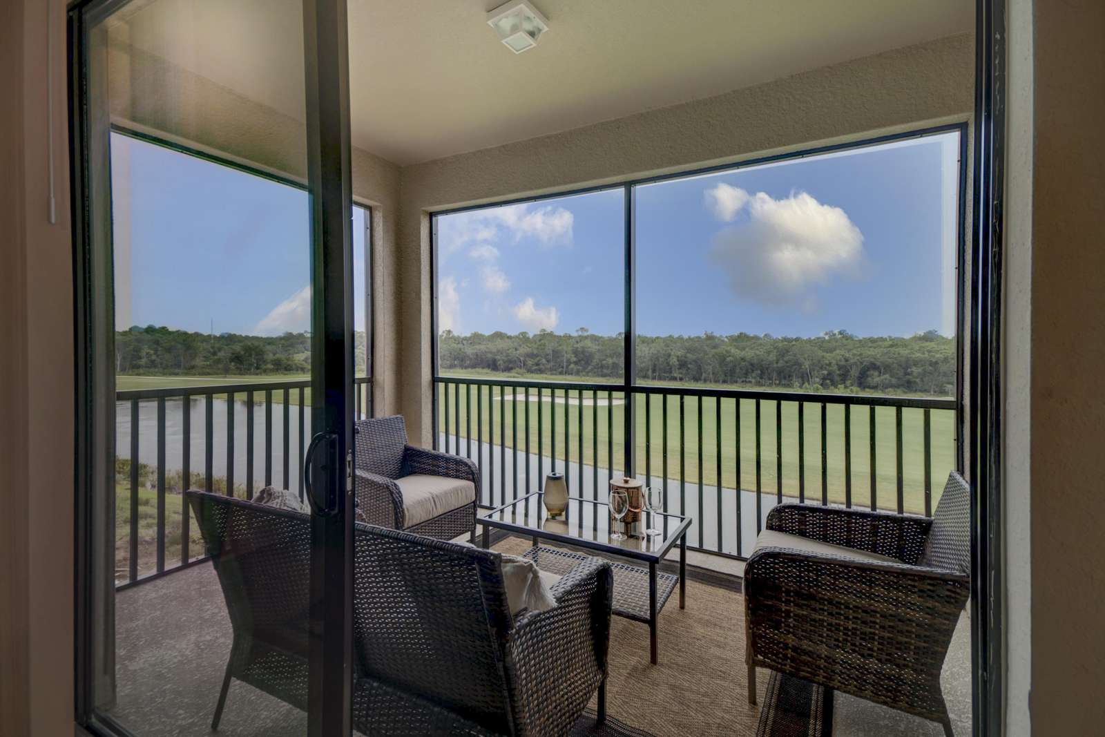 It's a golf and water-view dream from the coved lanai! - property