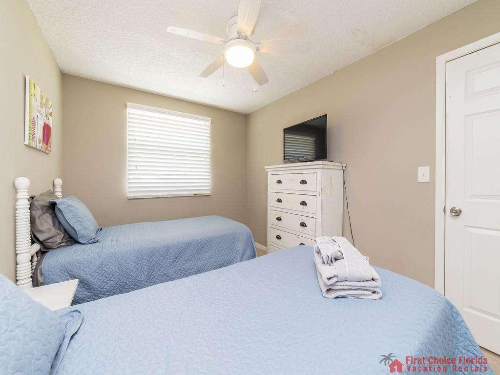 Island Retreat Unit D Bedroom with TVs