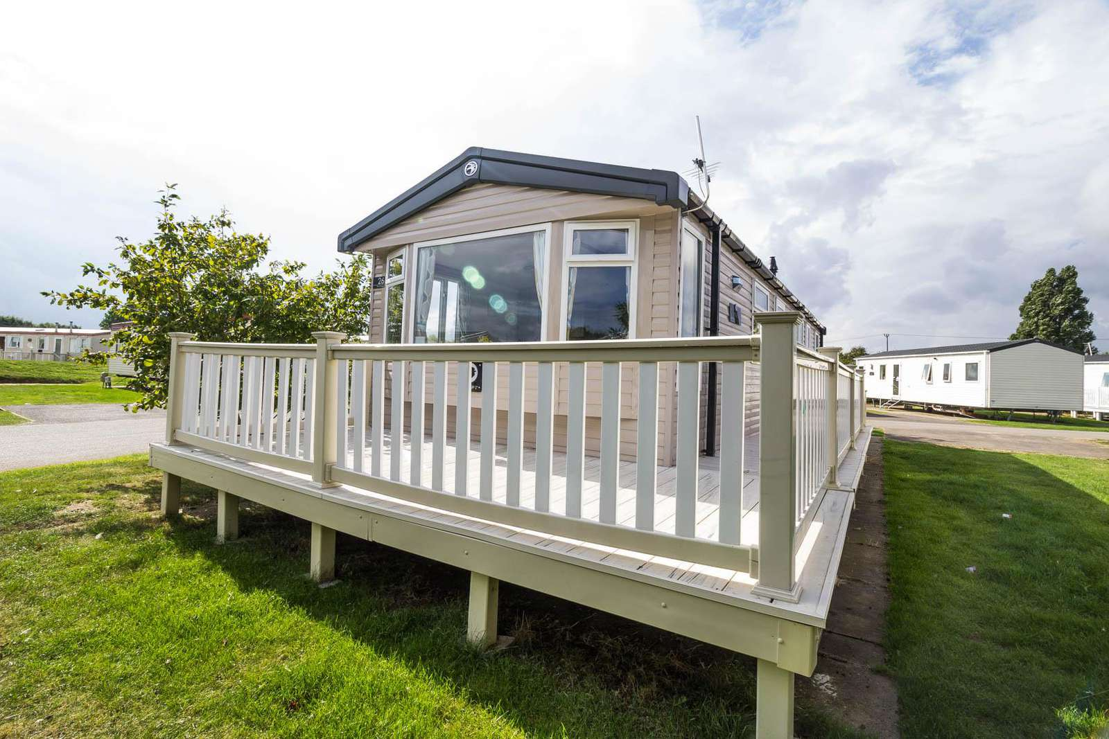 33026V – Vintage area, 3 bed, 8 berth caravan with decking. Diamond-Plus rated - property