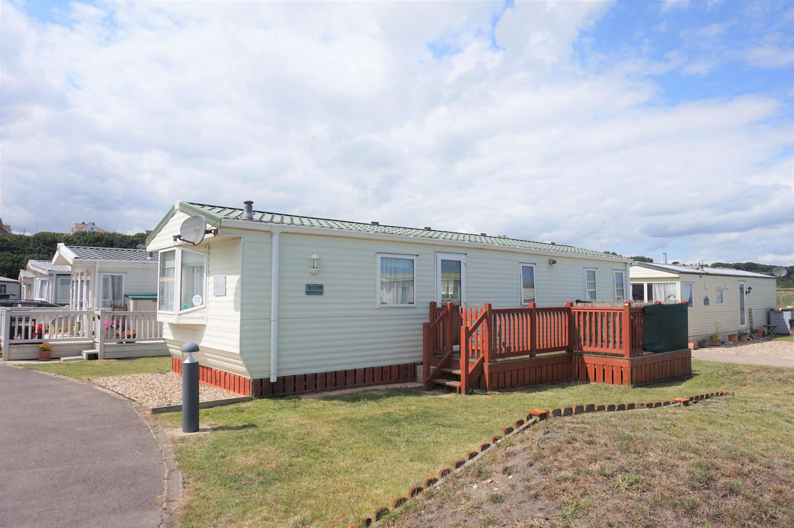 40023ND – North Denes, 2 bed, 6 berth with decking, D/G & C/H. Ruby rated. - property