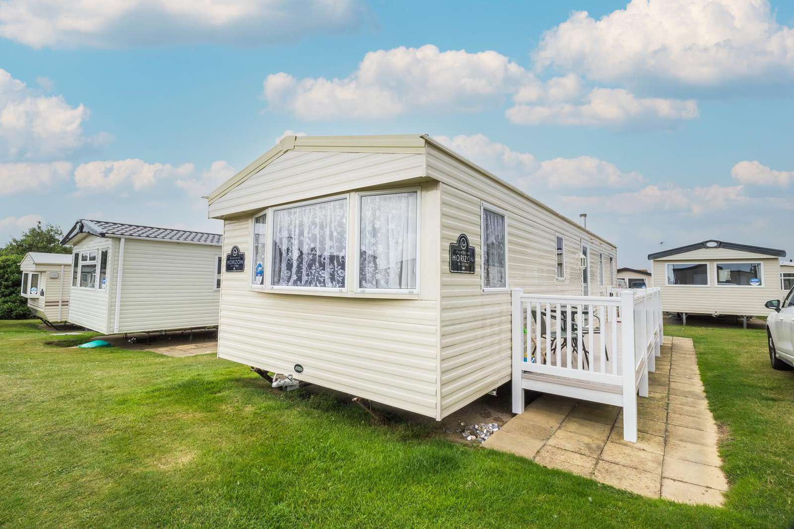 80041F – Fairways area, 3 bed, 8 berth caravan with decking to the side. Ruby rated - property