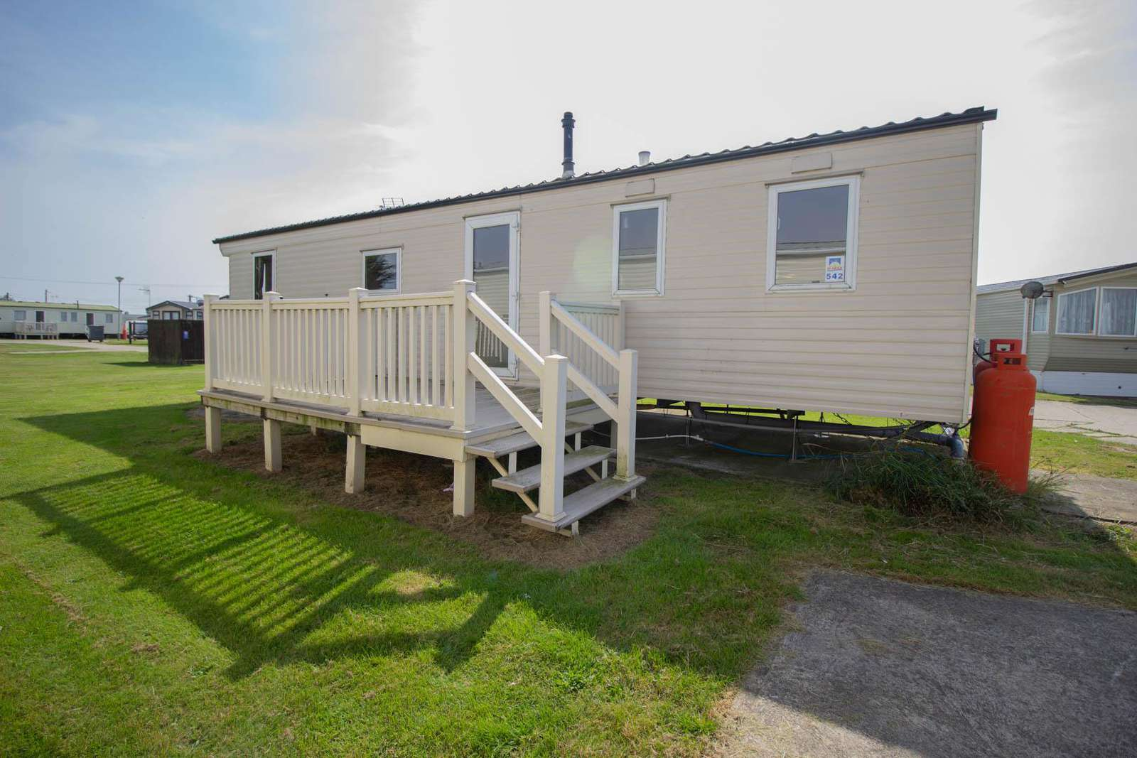 27542S – Seawick, 3 bed, 8 berth caravan with decking, D/G & C/H. Ruby rated. - property