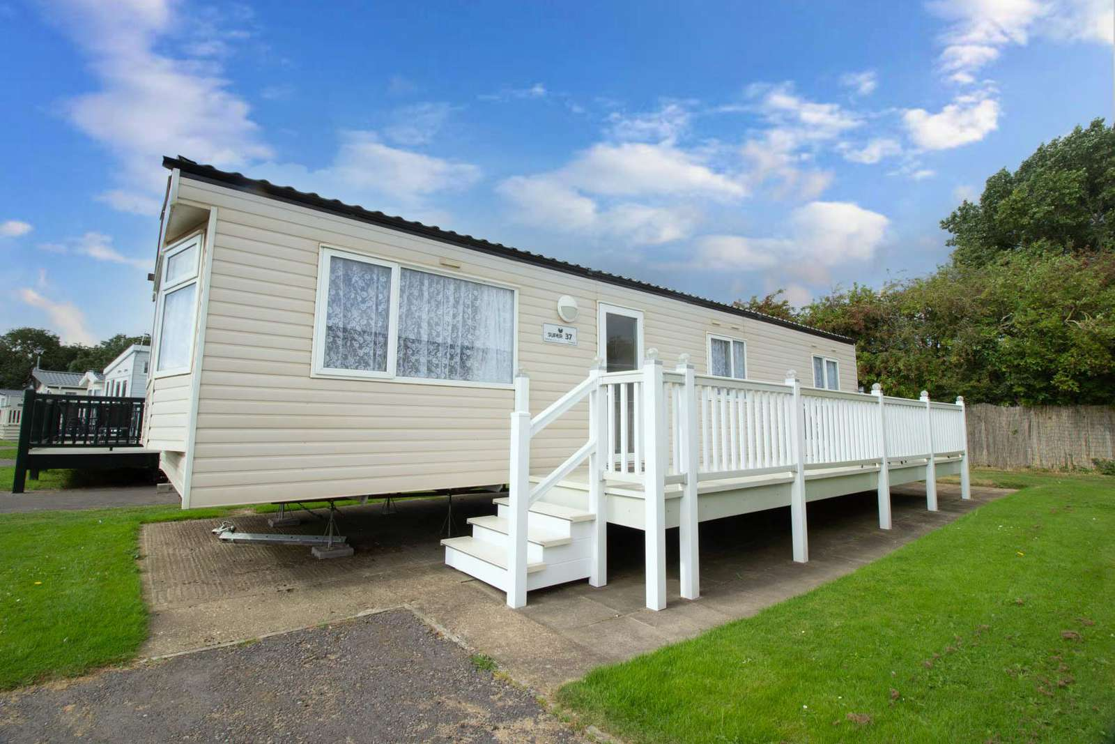 35001JW – Jubilee Way area, 3 bed, 8 berth caravan with decking, D/G and C/H. Diamond rated. - property