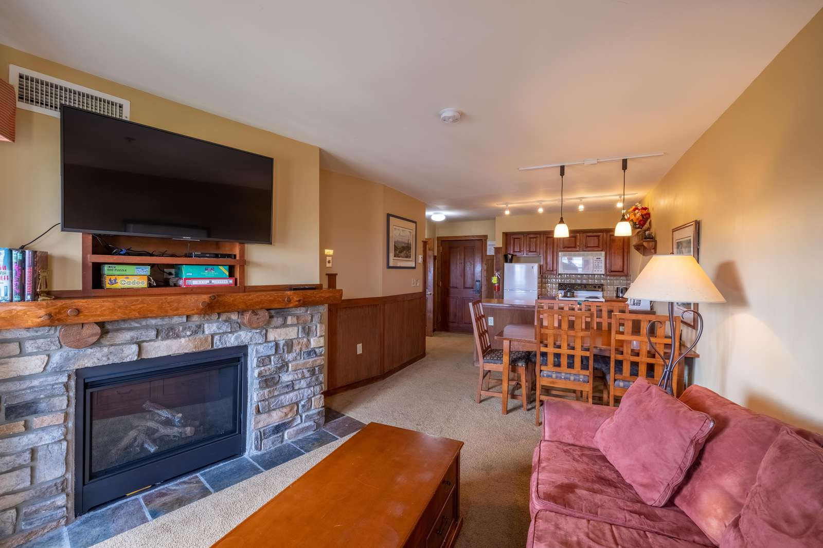 Cozy up to the gas fireplace and gaze at the beautiful mountain scape sunrise! - property