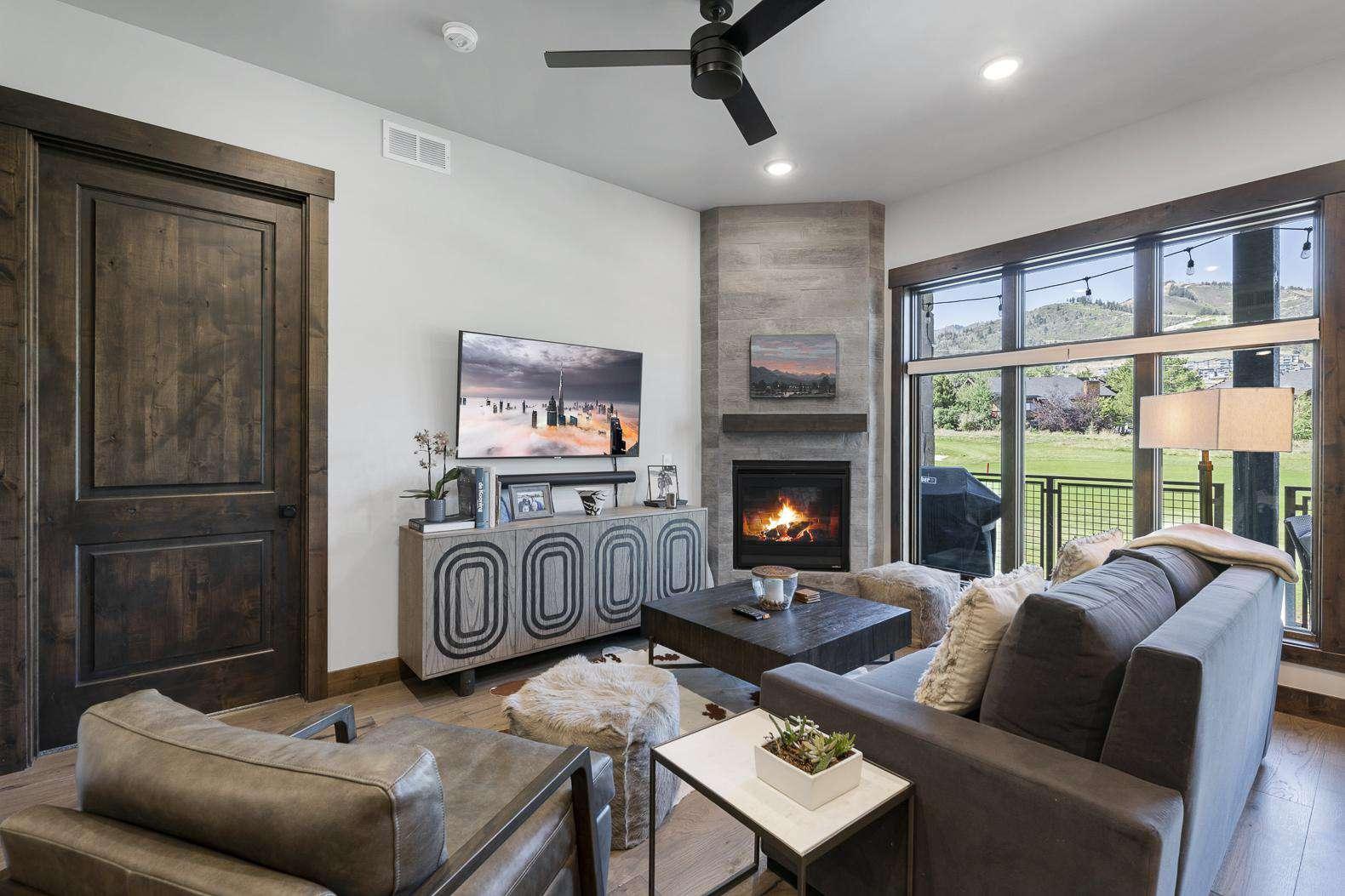 Living Room w/TV & Fireplace