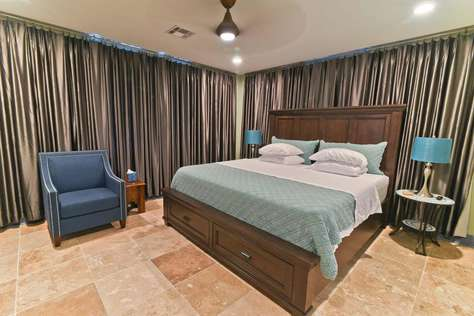 Creole King Room at Crescent Moon Villas