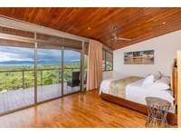 Master bedroom, king bed, ocean views, access to private balcony thumb