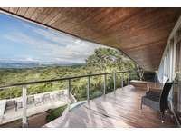 Master bedroom balcony ocean and forest views thumb